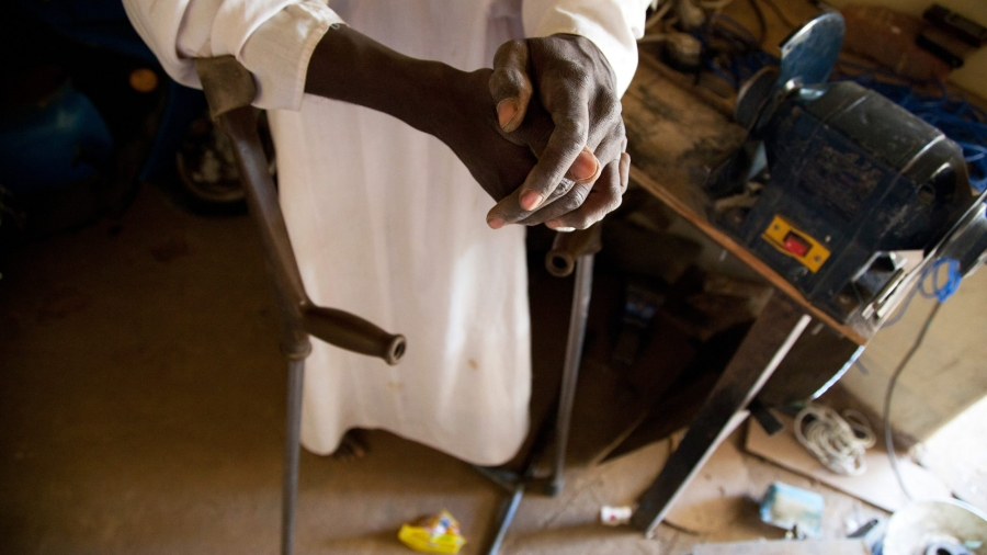 2 November 2011. El Fasher: Sheij Aldine is a member of the  center of the Sudanese Association for Disabled People in El Fasher. He works at the workshop, making crutches, wheelchairs and special shoes for disabled persons. He is also disabled and he is given a motorbike by the organization to facilitate his mobility.  The organization takes care of all disabled people in Darfur. Photo by Albert Gonzalez Farran - UNAMID
